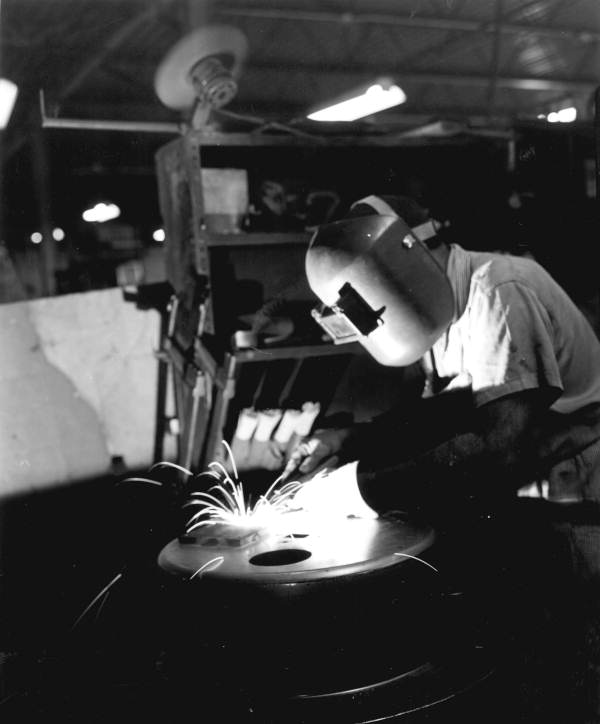 An employee working on welding at the Jackson Products Company - Tampa, Florida.