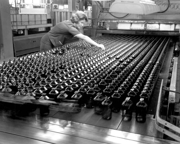Worker on the glass assembly line - Tampa, Florida .