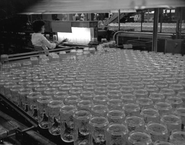 Woman checks glass on the assembly line - Tampa, Florida .