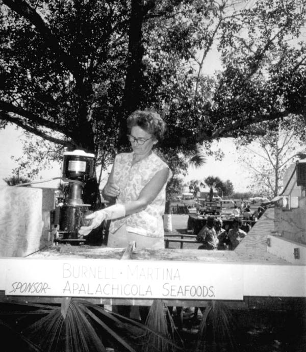 Unidentified woman in the Burnell Martina oyster shucking booth at the Florida Seafood Festival