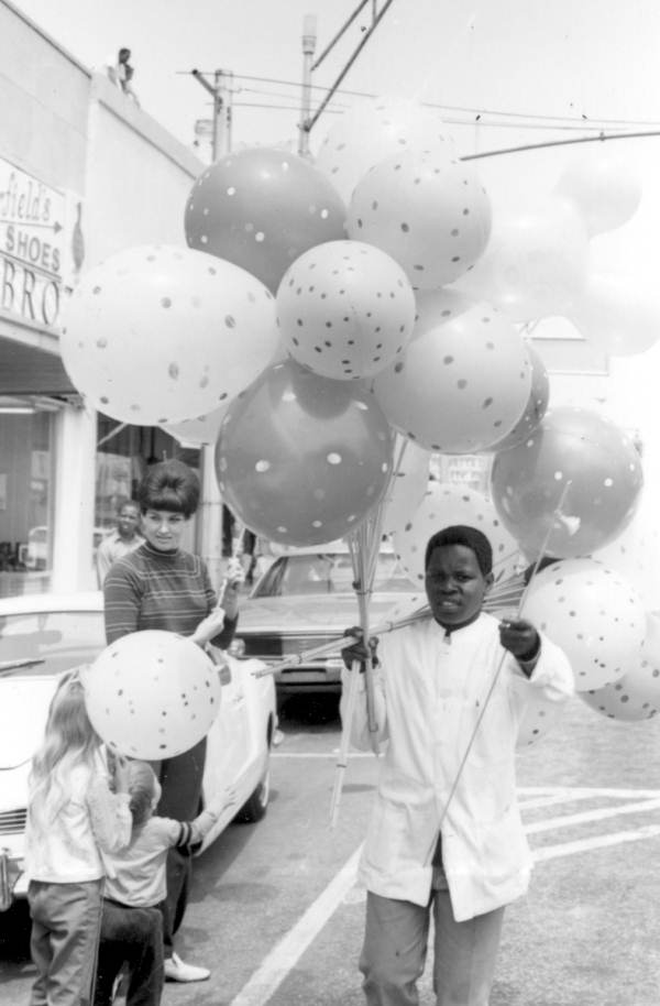 Young boy selling balloons during Springtime Tallahassee.