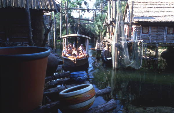 Visitors on an African Queen boat ride in the Stanleyville fishing village attraction at Busch Gardens amusement park - Tampa, Florida.