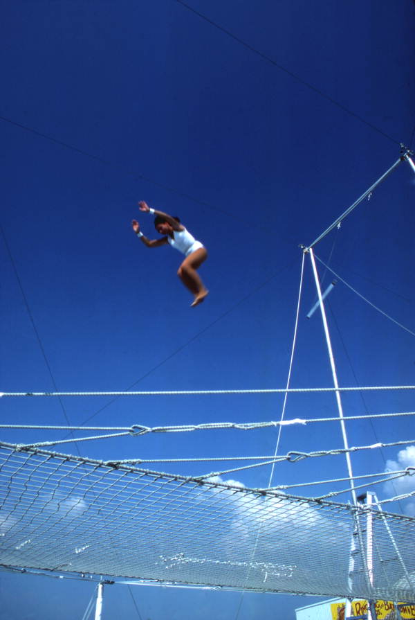 Trapeze artist performing at the Circus World theme park in Orlando, Florida.