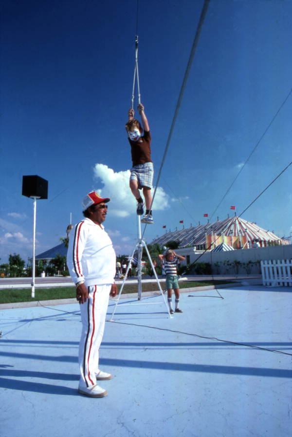 Child being given instruction on tightrope walking at the Circus World theme park - Orlando, Florida.