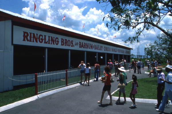 View showing visitors walking by a Circus World theme park building in Orlando, Florida.