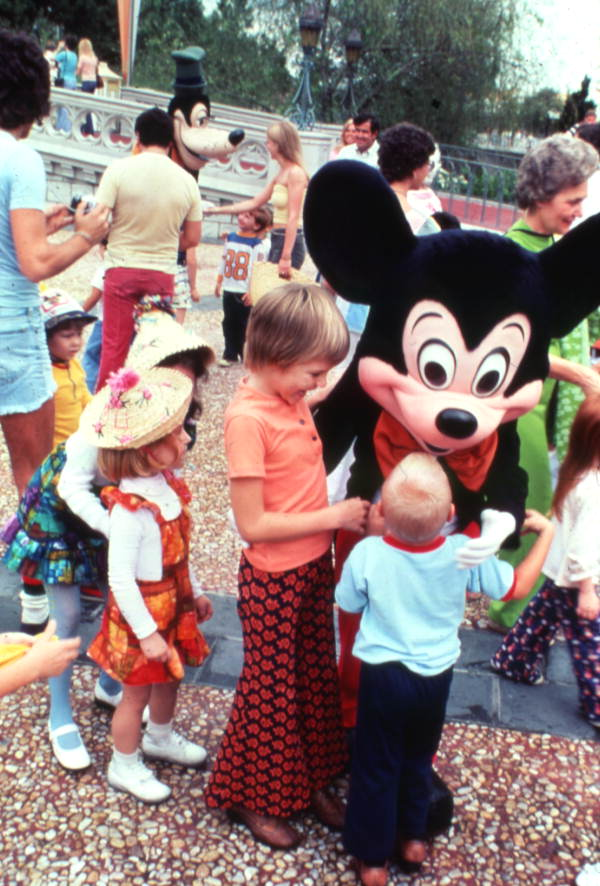 Children meeting Mickey Mouse at the Magic Kingdom amusement park in Orlando, Florida.