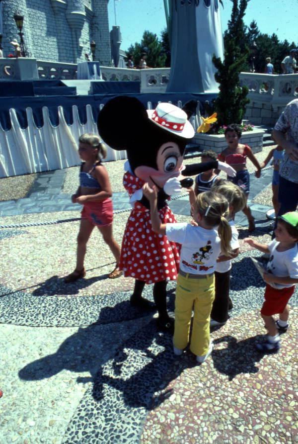 Children meeting Minnie Mouse at the Magic Kingdom amusement park in Orlando, Florida.