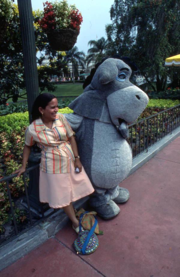 Visitor meeting Eeyore at the Magic Kingdom amusement park in Orlando, Florida.