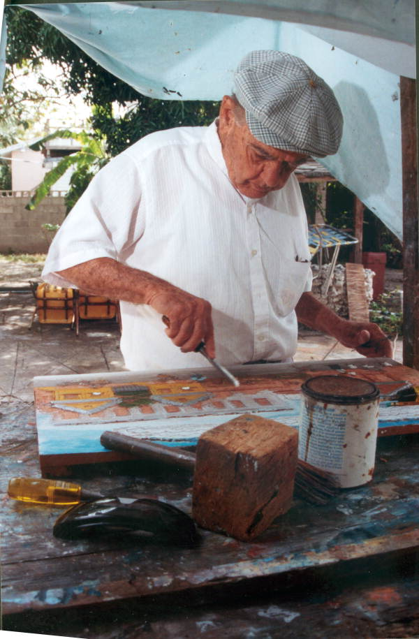 Mario Sanchez at work on his latest relief painting - Key West, Florida.