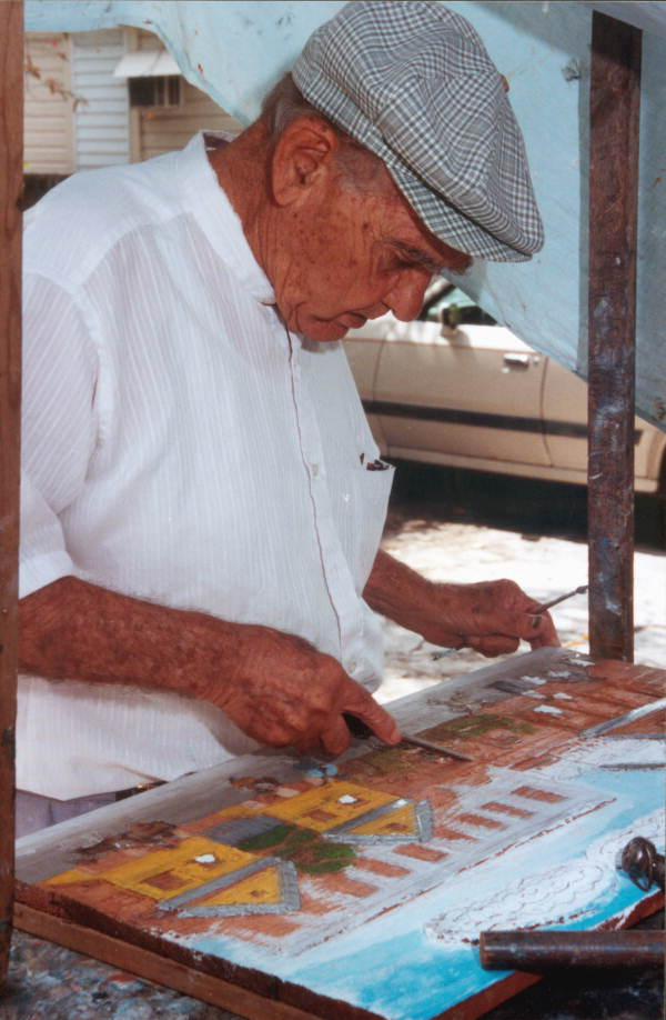 Mario Sanchez working on his relief painting - Key West, Florida.