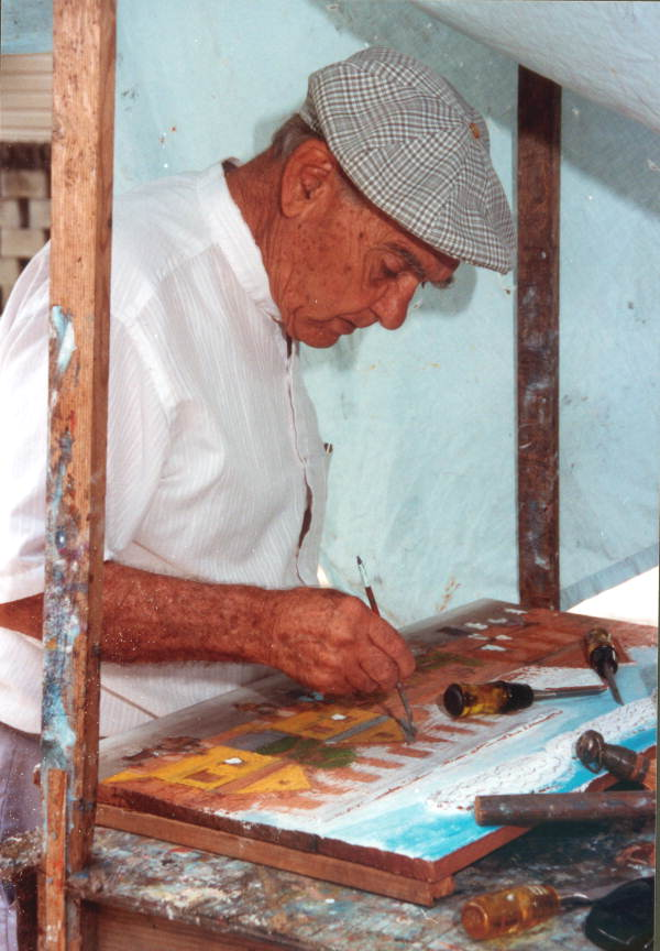 Mario Sanchez working on his latest relief painting - Key West, Florida.