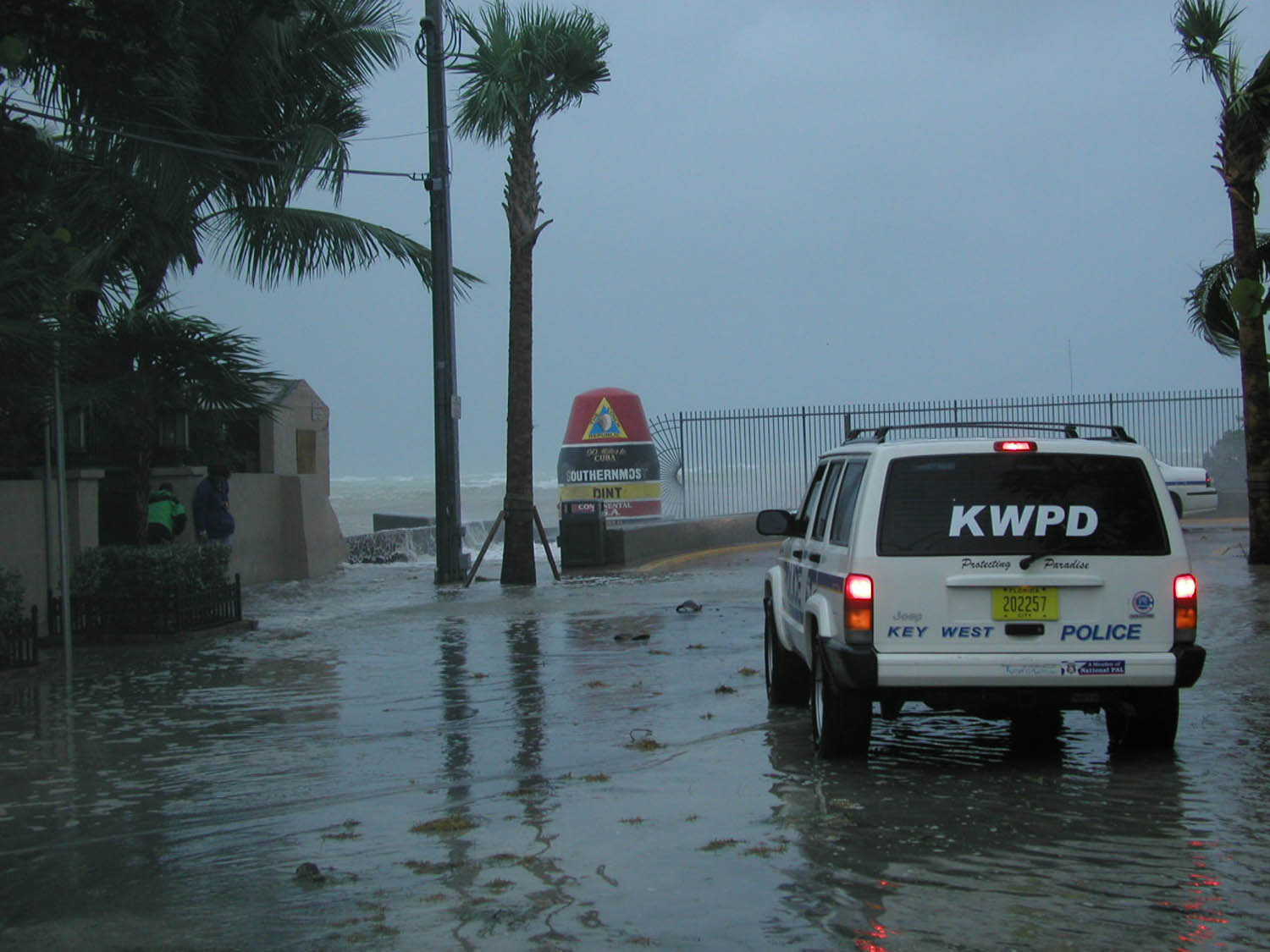 """Key West Police Department vehicle at the Southernmost Point """"Protecting Paradise"""" during Hurricane Charley."""