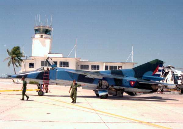 Cuban military personnel escorting Cuban MIG-23BN, that defected to NAS Key West, on to the flight line.
