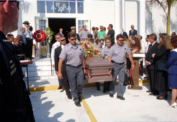 Members of the Key West Fire Department carrying casket of fallen fire chief's wife following funeral service - Key West, Florida.