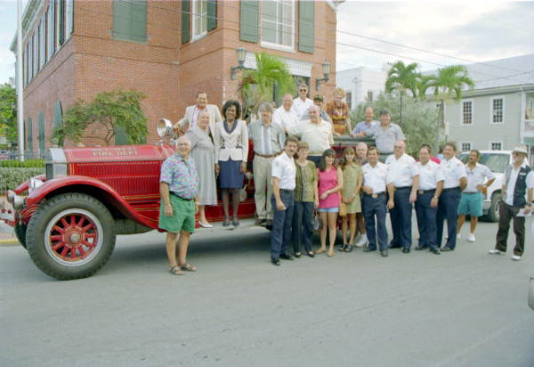 Group photo of city officials on the 1929 American La France pumper donated to Key West Firehouse Museum by Mr. Ed Swift.