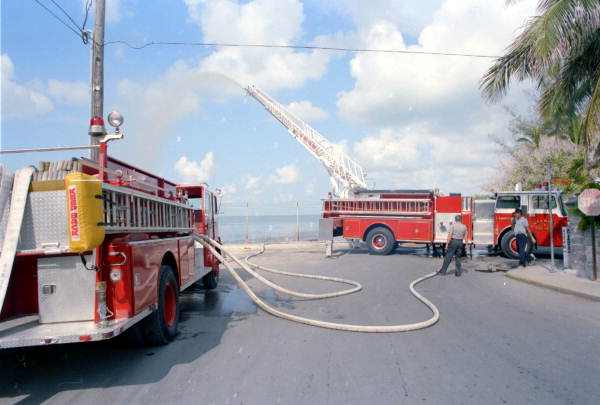 Key West Fire Department pumper #433 shown relaying water to the new LTI Ladder #1 truck at the Southernmost Point..