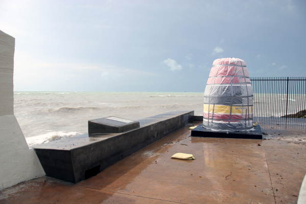 Southernmost Point marker covered up for protection from pounding surf from hurricane..