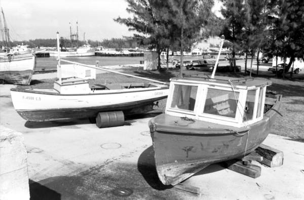 Haitian and Cuban refugee boats on pier D-2, United States Coast Guard station, Trumbo Point Annex, Key West, Florida..