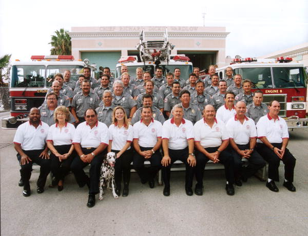 Group portrait of Key West Fire Department members in front of the main fire station on North Roosevelt Boulevard - Key West, Florida.