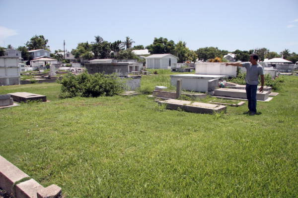 Alex Vega points out the Fire Dept. cemetery plot in the Key West Cemetery..
