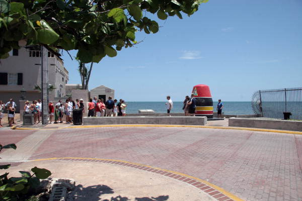 Tourists lined up for photographs at the Southernmost Point - Key West, Florida.