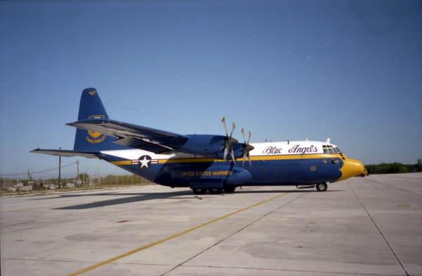 "U.S. Navy Flight demonstration team, the ""Blue Angels"", C-130 ""Hercules"" logistics aircraft parked on NAS Key West, FL flight line during air show."