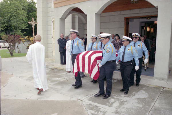 "NAS Key West Fire Dept. ""Honor Guard"" members at St. Mary's church escorting the casket of former NAS Key West firefighter Ralph Arnold Sr. following services on his behalf."