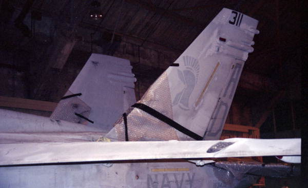 View showing damage to FA-18 Hornet jet aircraft that was involved in a mid-air collision, over NAS Key West, with an F-5 jet fighter.