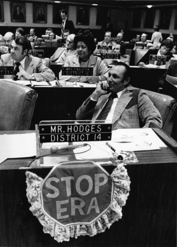 Rep. Gene Hodges and a sign opposing ERA amendment - Tallahassee, Florida.