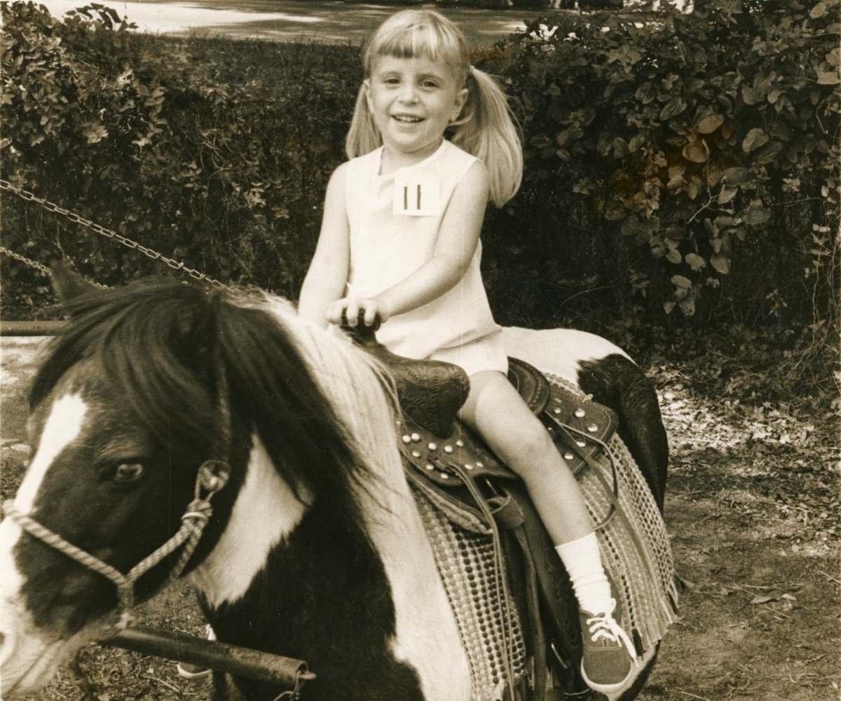 Leslie Dughi riding a pony at her sister's birthday party - Tallahassee, Florida.
