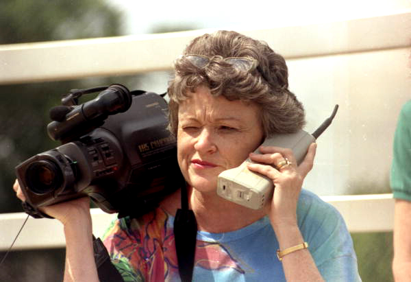 St. Petersburg Times reporter Lucy Morgan with video camera and phone.
