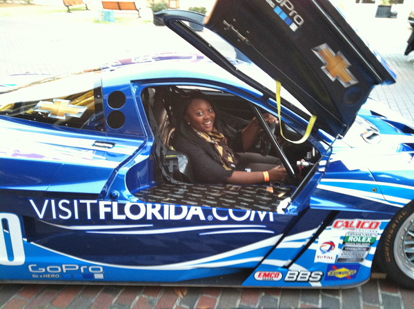Florida Department of State's Programs and Marketing Liaison Renee Smith sitting in race car at a street festival during Florida Tourism Day in Tallahassee, Florida.