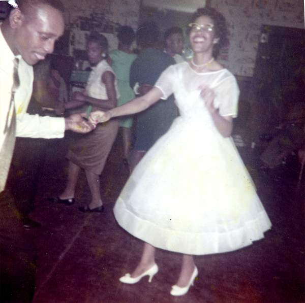 Newlyweds dancing at their wedding celebration in Tallahassee.