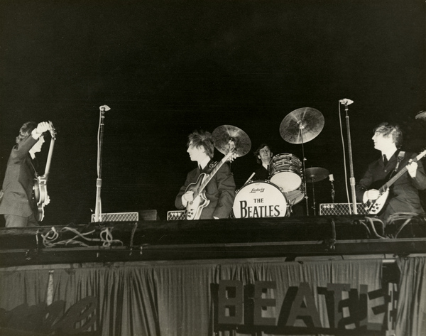 Beatles on stage at the Gator Bowl in Jacksonville.