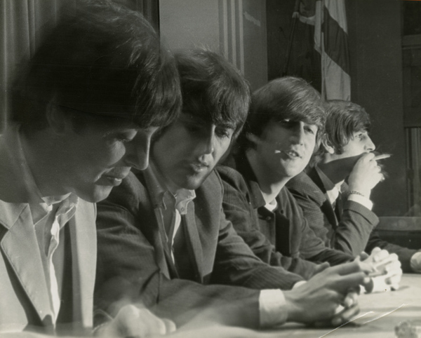 Beatles giving a press conference at the George Washington Hotel in Jacksonville.