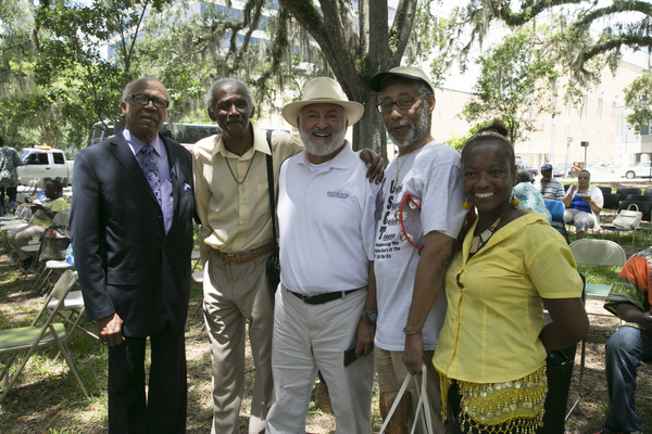Reverend Henry Steele posing with group during the Emancipation Day Celebration at the Knott House Museum in Tallahassee.