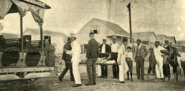 Wounded sailor being carried to the Marine Hospital at the Key West Naval Station.