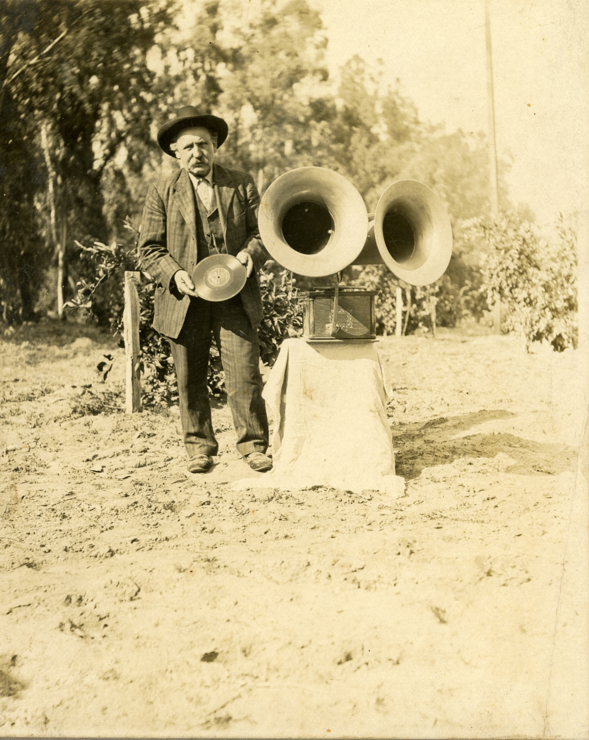 Man with dual horn phonograph in Ft. Myers.