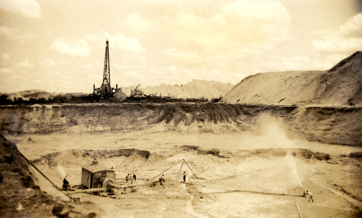 Swift & Co. miners creating slurry with pressurized water at a phosphate rock mine south of Ft. Meade.