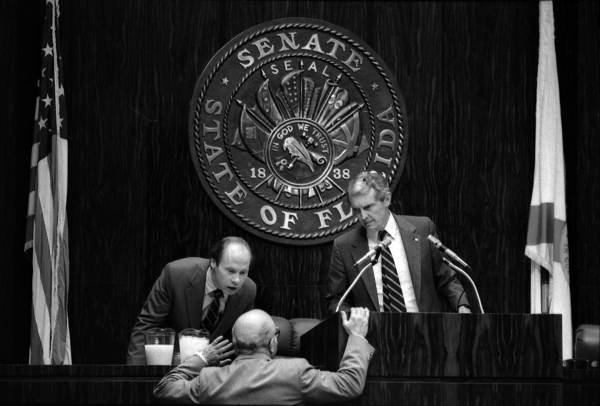 Senate President Harry Johnston talking with a couple senate members - Tallahassee, Florida.