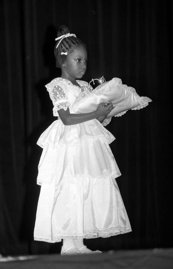 Little girl holds a crown - Tallahassee, Florida.