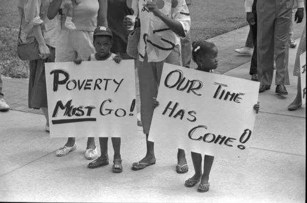 Children with signs that protest poverty - Tallahassee, Florida.