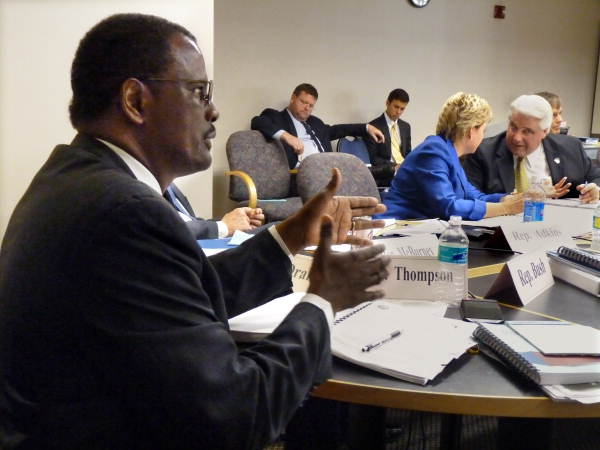 Florida State Representative James Bush III, D-Miami, questioning a presenter before the Government Accountability Act Council in Tallahassee, Florida.