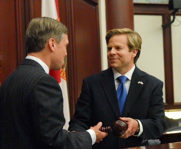 House Speaker Dean Cannon, R-Winter Park, left, passing the gavel to Senate President Mike Haridopolos, R-Melbourne, during a joint session of the Legislature.