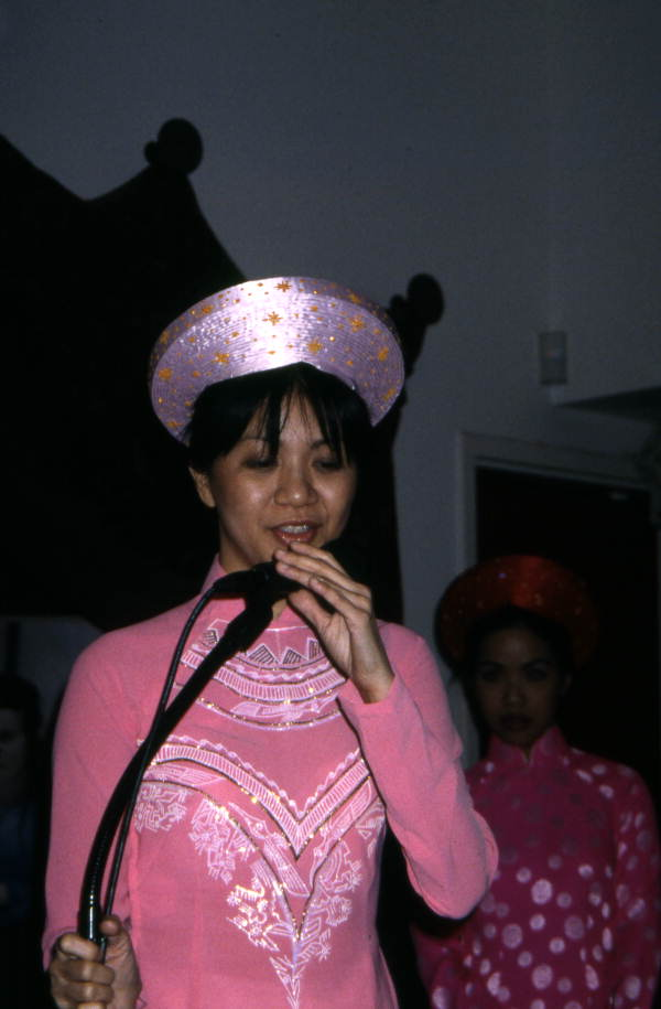 Member from Tina Nguyen's music group singing traditional Vietnamese songs during a concert sponsored by the Florida Folklore Society in Orlando, Florida.