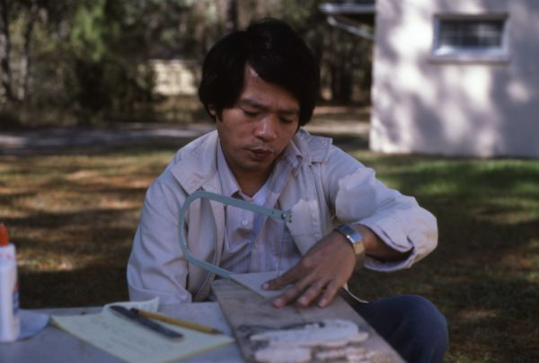 Tuan Nguyen, of Tampa, working on Vietnamese Cualong woodcarvings at the 1986 Florida Folk Festival in White Springs.