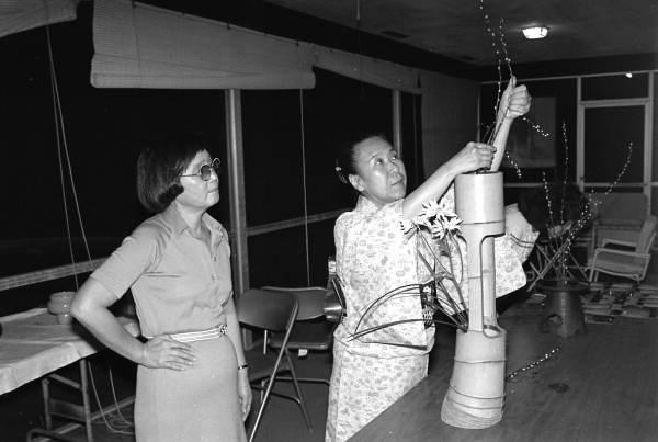 Sumino McGlamory (L) observes as Atsuko Lefcourte makes Ikebana floral arrangement- Palm Beach, Florida.