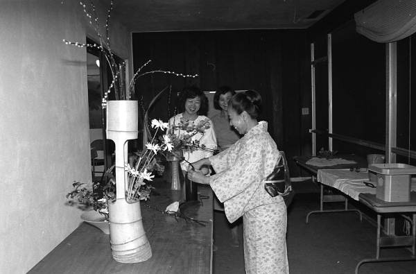 Kathy Leventhal (L) and Sumino McGlamory observe as Atsuko Lefcourte makes Ikebana floral arrangement- Palm Beach, Florida.