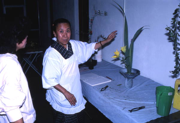 Kathy Leventhal (L) observes as Atsuko Lefcourte makes Ikebana floral arrangement- Lake Park, Florida.
