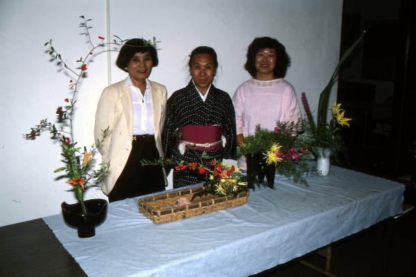 Sumino McGlamory (L), Atsuko Lefcourte, and Kathy Leventhal (R) stand with their Ikebana floral arrangements- Lake Park, Florida.